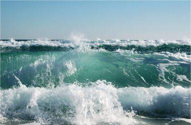 Wave crashing on the beach in pensacola florida